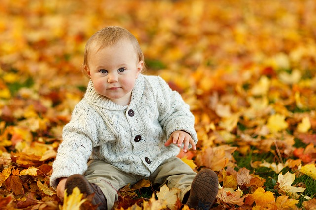 Image of a child during the fall season.